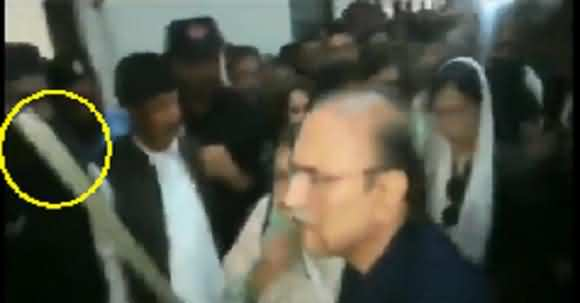 Asif Ali Zardari Hits Police Man With His Stick Before Presenting In Court