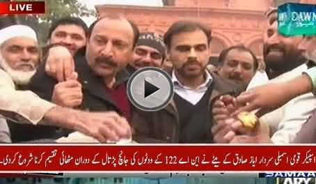 NA Speaker Ayaz Sadiq's Son Distributes Sweets During NA-122 Votes Verification Process