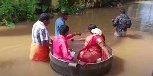 Necessity is The Mother of Invention - Indian Couple Float to Wedding in Cooking Pot After Floods in Kerala