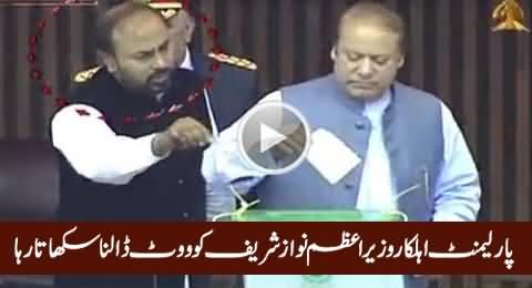 Parliament Employee Teaching PM Nawaz Sharif How To Cast Vote