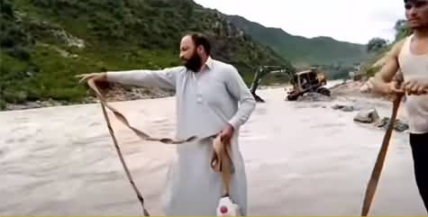 See How Civil Defence Team Rescued The Boy in Swat Who Was Stuck in Flood