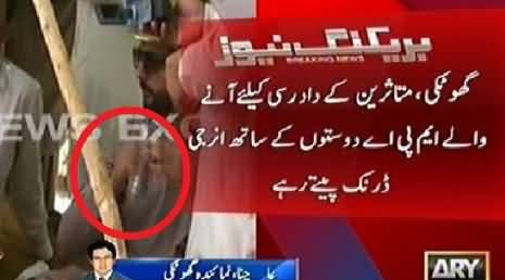 Shameful: PPP MPA Drinking Red Bull During His Visit to Flood Victims in Ghotki