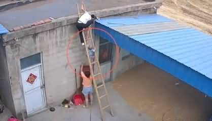 Take Care of Your Toddlers - Chinese Mother Catches 2 Year Son Just Before Falling From Ladder