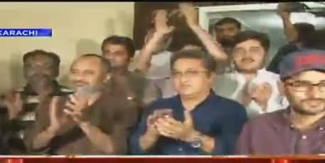 Youth Gathered Outside Mustafa Kamal's House Holding Pakistani National Flag